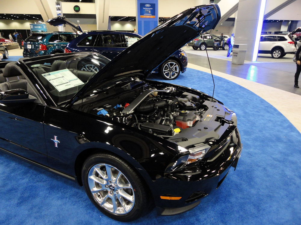 Black Ford Mustang displayed with hood open