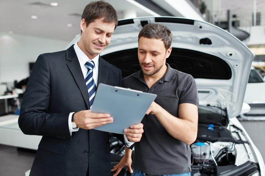 Young man buys a car