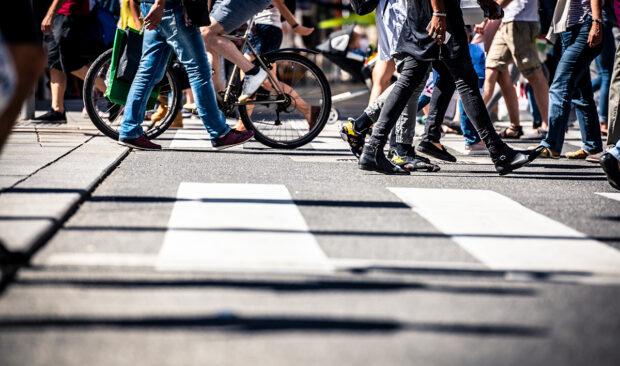 An image of pedestrians crossing a cross walk.