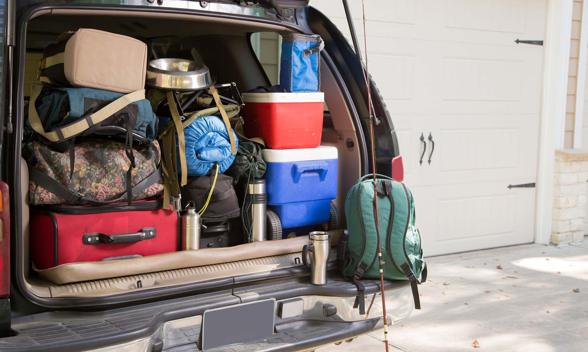 A car trunk full of camping gear.