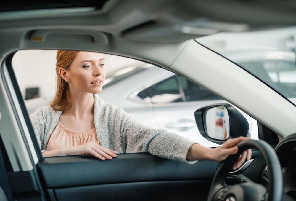 woman choosing a car