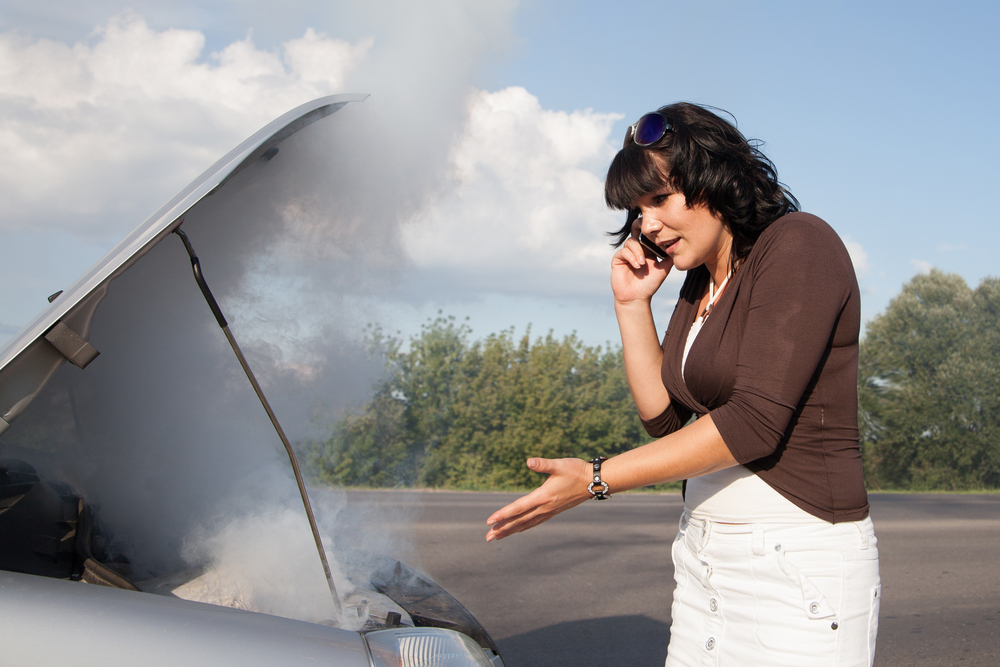 woman-calling-roadside-assistance