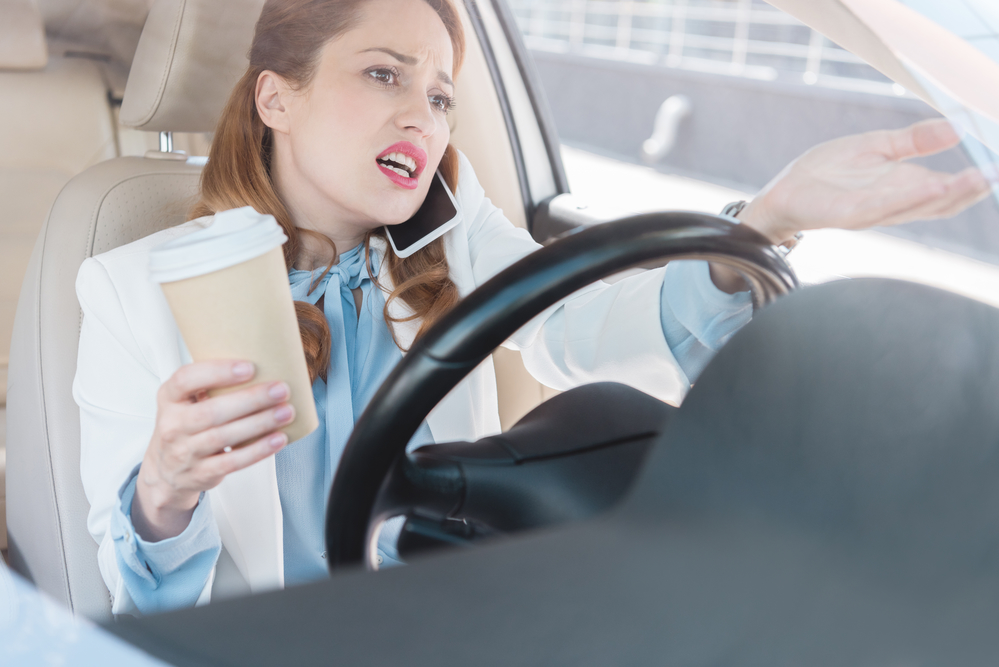 distracted woman driving