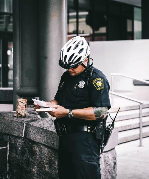 Uniformed Policeman Writing Ticket
