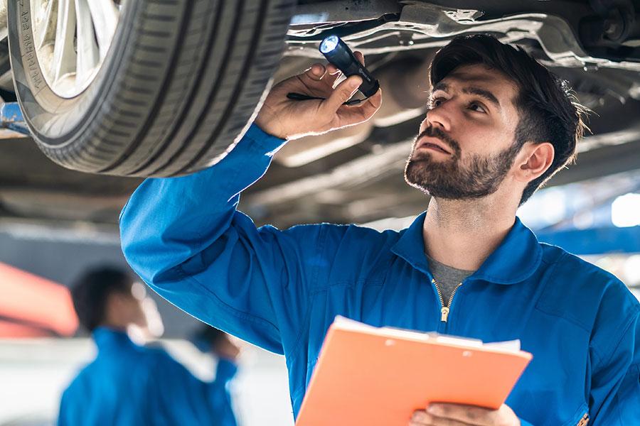 A mechanic checking a car