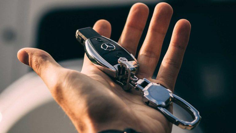 car key fob in hand