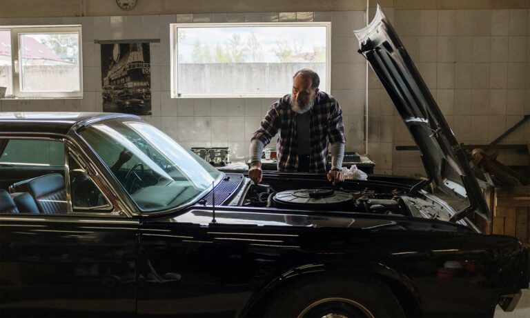A man working on his car.