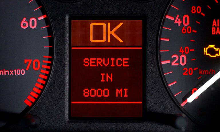 A car's odometer that reads,