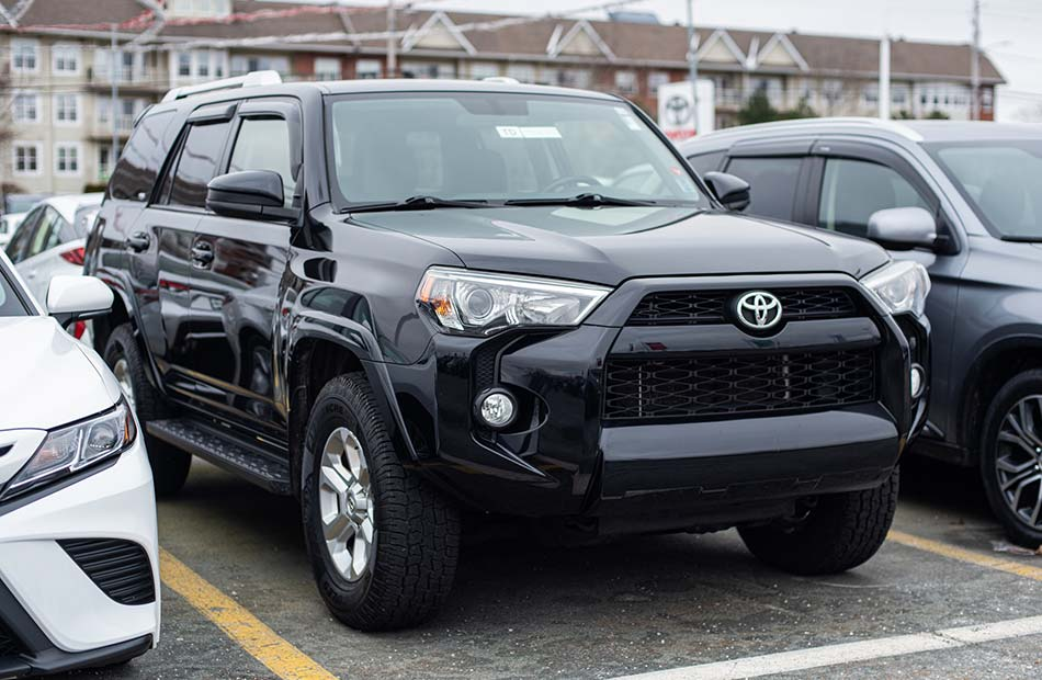A black Toyota 4Runner parked in a parking lot.