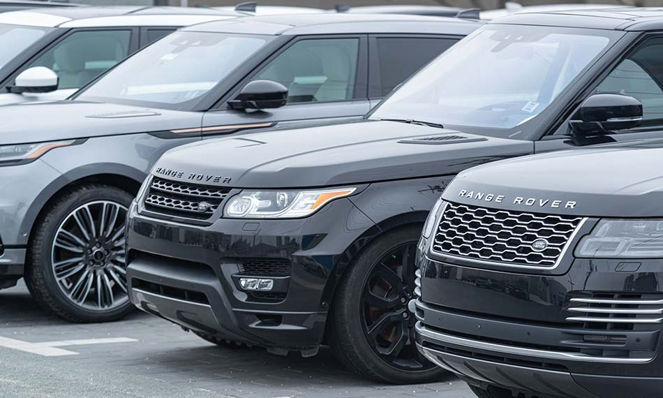 An image of three Range Rovers parked next to each other.