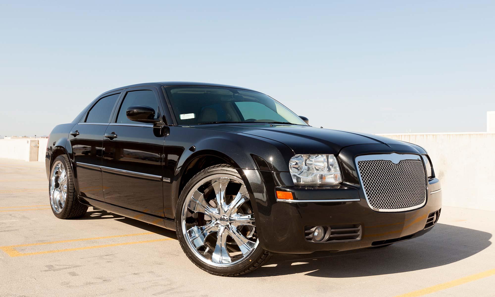 A black Chrysler 300.