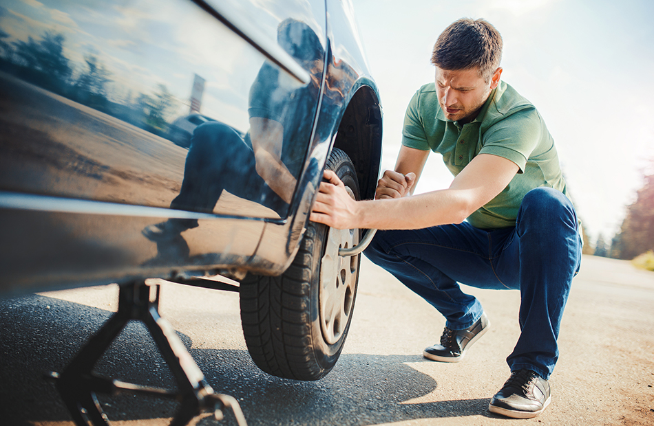 Replacing flat tire.