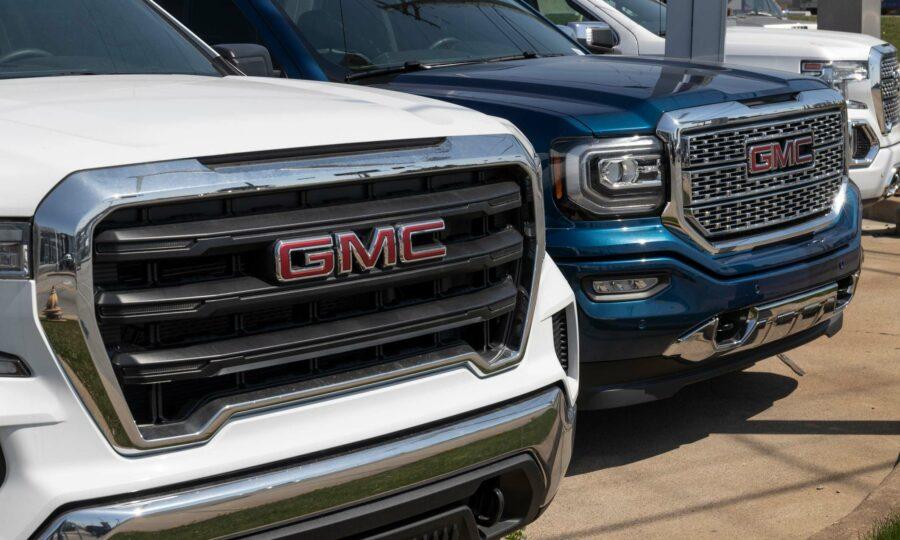 Two GMC Sierra trucks.