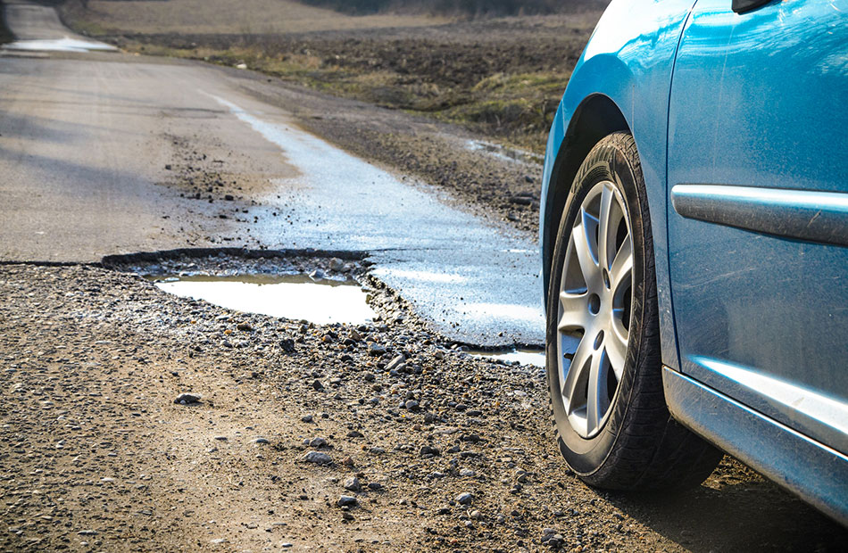 A pothole in the road.