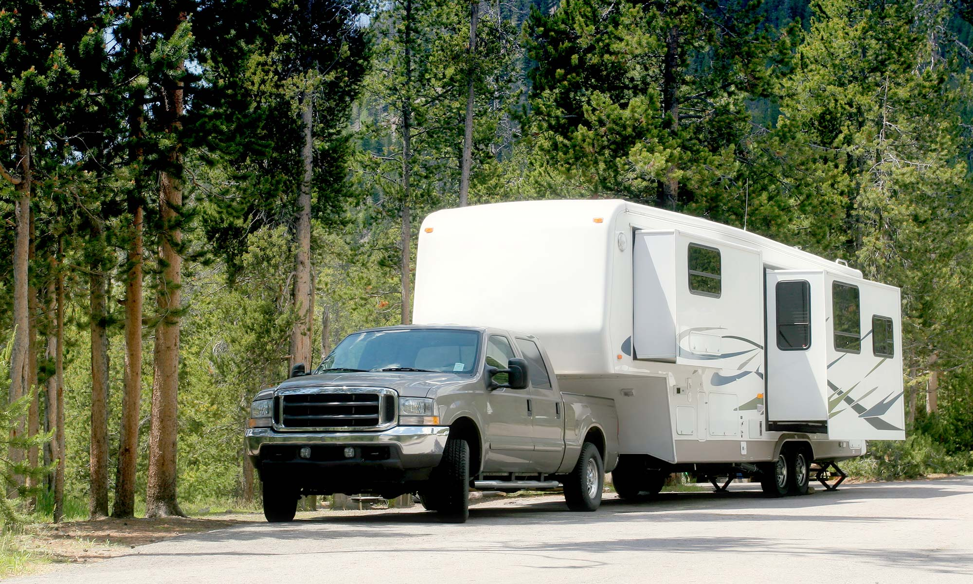 A pickup towing a camper.