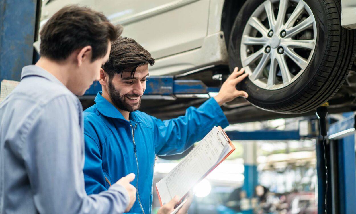 A mechanic speaks to a customer.