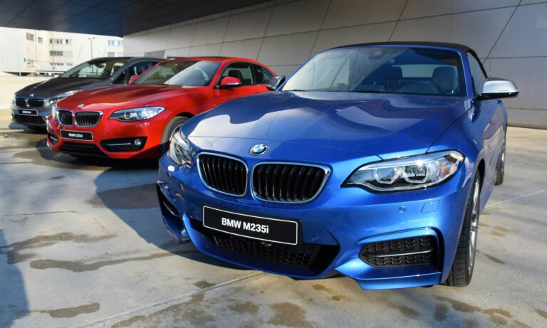 Three brand new BMW vehicles parked in a row.