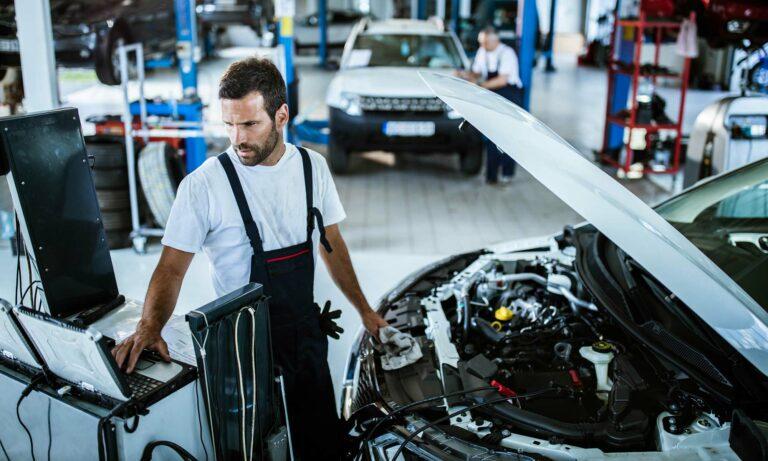Mechanic performing engine diagnostic check.