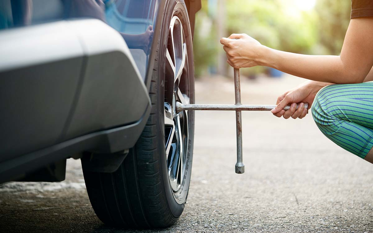 A woman changing a vehicle