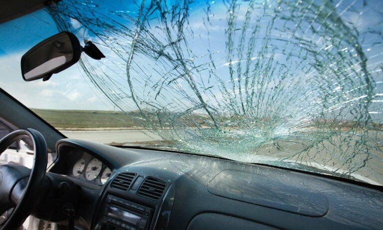 A severely damaged car windshield.