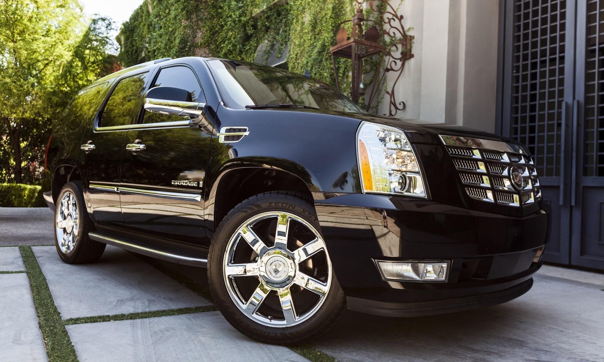 A photo of a black parked Cadillac Escalade